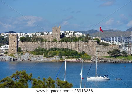 BODRUM, TURKEY - APRIL 12, 2014: View to the St. Peter's castle, harbor, and city. Built in XV century, now the castle housed the Museum of Underground Archeology