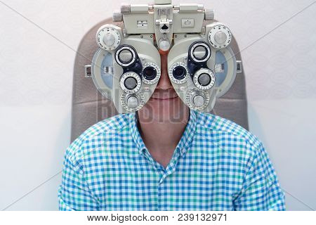 Man Ophthalmologist Examining Patient Man With Optometrist Trial Frame. Male Patient To Check Vision