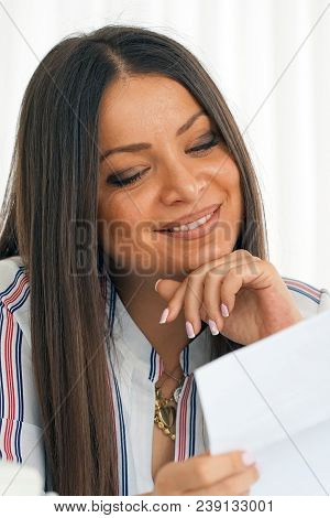 Woman Enjoying Good News In Writing. The Girl Reads A Letter With Good News. An Euphoric Girl Is Hap