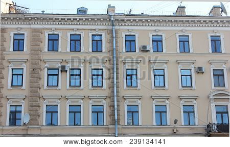 Building Facade Classic Architecture With Windows In Row. Symmetric Old Historical Minimalist House
