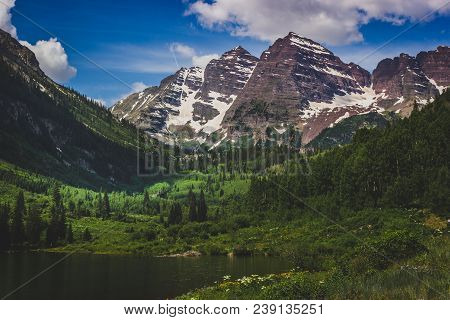 Majestic Maroon Bells Peaks And Maroon Lake On A Sunny Day And Blue Sky In Summer Near Aspen, Colora
