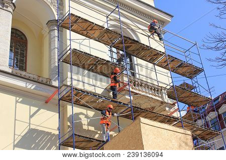 St. Petersburg, Russia - April 9, 2018: Construction Workers Working On High Scaffold During Facade