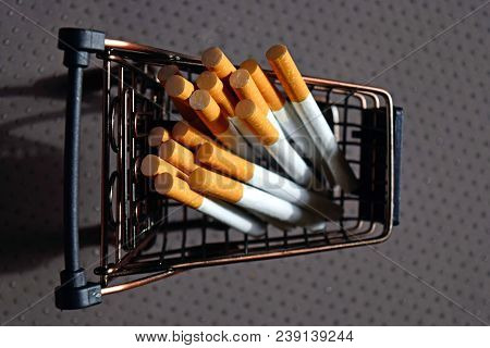 A Bunch Of Cigarettes Lying In A Metal Mini Cart