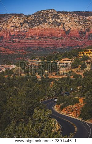 Winding Airport Road Viewed From Sedona Airport Vortex With Colorful Red Rock Formations In The Back