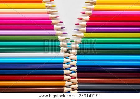 Set Of Colored Pastel Pencils In Row Multi Color In Form Of Open Zipper And Pencil Sharpener Concept