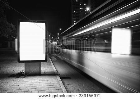 Advertising Billboard Near The Road. White Billboard. Blurred Motion. Mock Up.