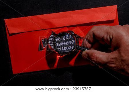 The Binary Encryption Code Is Hacking And The Hacker Reads The Cipher Via A Magnifying Glass.