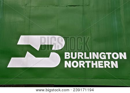 Nisswa, Minnesota, April 24, 2018: The Bn Logo On The Side Of The Green Caboose Was Once Property Of