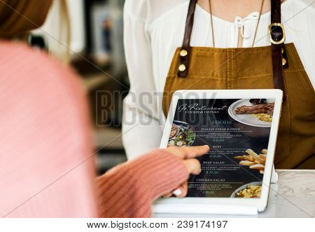 Customer ordering food at restaurant counter