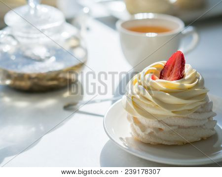 homemade cream cake on table in sunny room, tea party