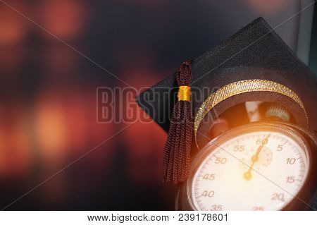 Abroad International Educational Program Concept : Graduation Cap On Top Retro Alarm Clock With Colo