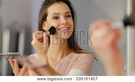 Beauty Blogger. Natural Style Makeup. Young Beautiful Girl Applying Blush In Front Of The Mirror