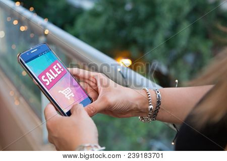Girl Holding A Smartphone A Sale Advertising On The Screen. Marketing, Discount, Internet, Cell Phon