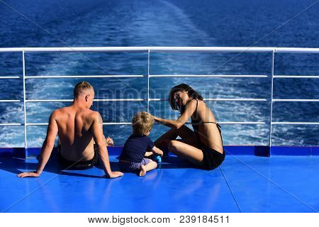 Summer Vacation Of Happy Family. Mother And Father With Son In Sea On Yacht. Family Travel With Kid