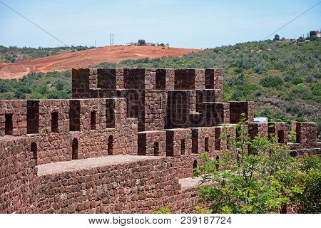 Silves, Portugal - June 10, 2017 - View Of The Medieval Battlements And One Of The Towers Inside The