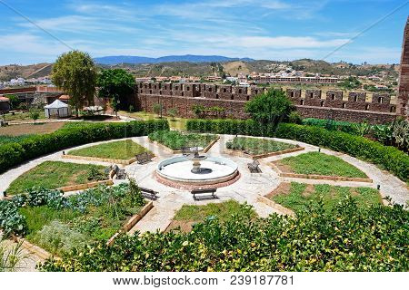 Silves, Portugal - June 10, 2017 - Botanical Gardens With A Fountain To The Centre Inside The Mediev
