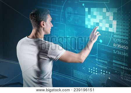 Web Developer. Experienced Web Developer Touching The Transparent Screen And Looking Interested Whil