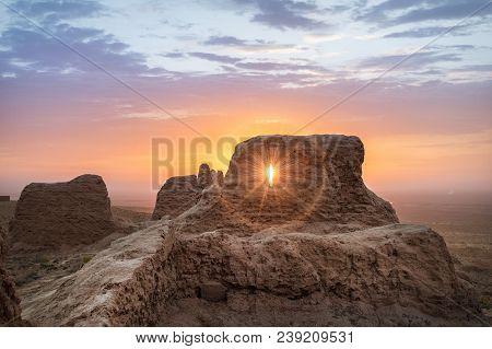 Rays Of Rising Sun Permeate Through Ruins Of Ancient Ayaz Kala Fortress In Kyzylkum Desert, Uzbekist