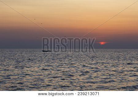 Fishing Boat Sailing At Sunset In Croatia, Adriatic Sea