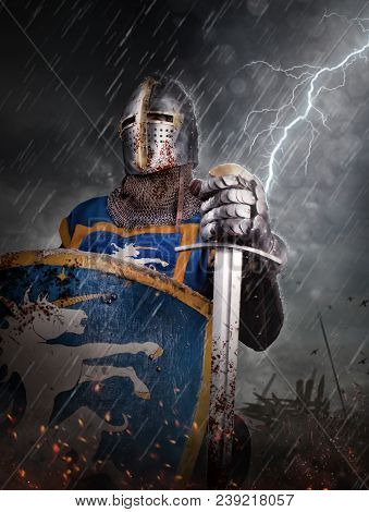 Lightning Strikes A Knight On Battlefield. Knight With Sword In Battlefield.