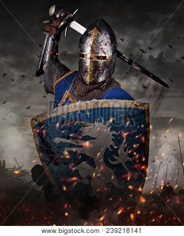 A Knight With Sword Under The Rain On Battlefield. Knight With Sword In Battlefield With Dark Clouds