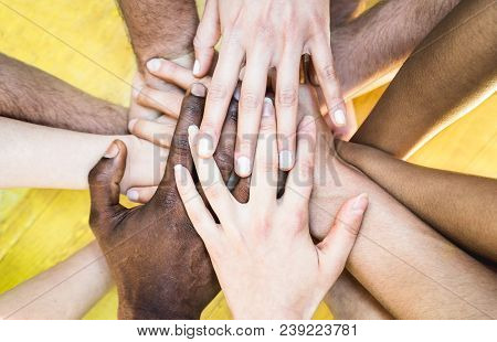 Top View Of Multiracial Stacking Hands - International Friendship Concept With Multiethnic People Re