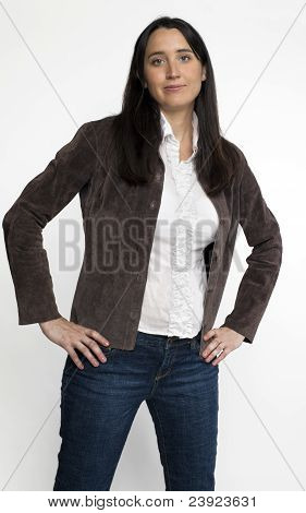Woman in suede jacket with hands on hips
