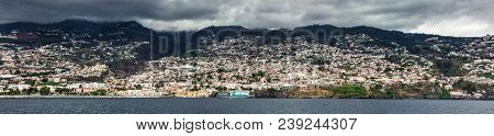 Panorama Of Coastline. Funchal, Madeira With High Cliffs Along The Atlantic Ocean. Dramatic Sky. Bea