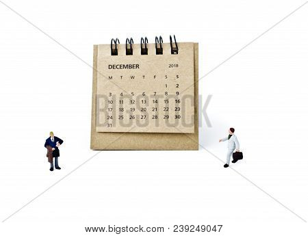 December. Meeting In December. Two Thousand Eighteen Year Calendar And Two Miniature Plastic Busines