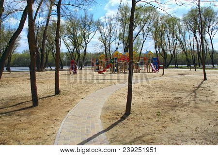 Footpath Leading To Childish Playground In City Park. Modern Playground For Kids