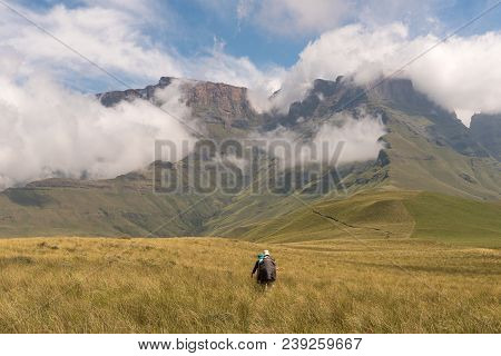 Injisuthi, South Africa - March 20, 2018: Hikers On The Contour Path Above The Van Heiningen Pass At