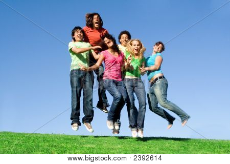 Happy Group Of Teens Jumping  - Some Motion Bur