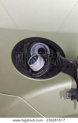 Car Fuel. Car Fuel Filler Cap. Auto Fuel Tank. Opened Automobile Oil Tank.