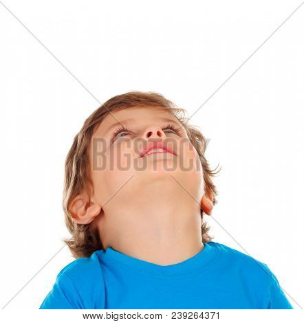 Pensive small child looking up isolated on a white background