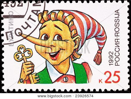 Canceled Russian Postage Stamp Pinocchio Puppet Holding Gold Key