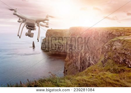 drone flying over the Cliffs of Moher, Co. Munster, Ireland, in the evening sun. Background is intentionally blurred