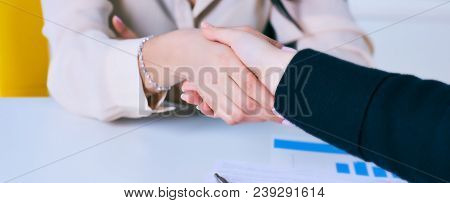 Young Woman Arriving For A Job Interview. Business People Handshake In Modern Office. Greeting Deal