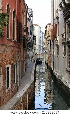Many Houses Near The Narrow Water Way In Venice Italy