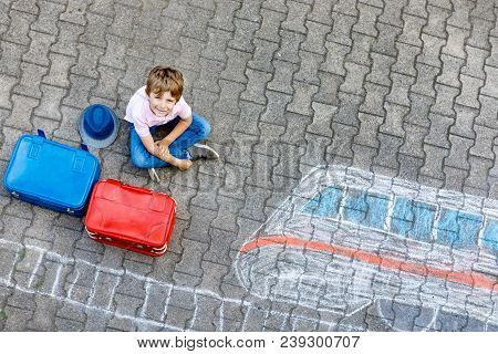 Little Kid Boy Having Fun With Fast Train Picture Drawing With Colorful Chalks On Asphalt. Child Pai