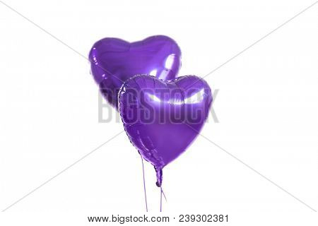 holidays, valentines day and party decoration concept - close up of inflated helium heart shaped balloons over white background