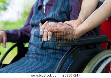 Holding Hands - Parkinson Disease