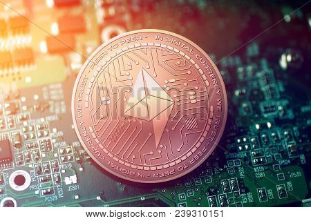 Shiny Copper Farad Cryptocurrency Coin On Blurry Motherboard Background Token