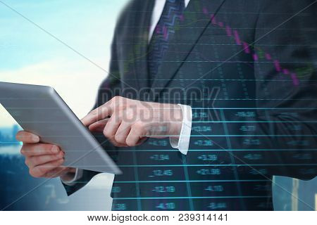 Side View Of Businessman Hands Using Touchpad On Abstract City Background With Forex Chart. Currency