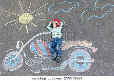 Creative Leisure For Children: Funny Little Child Of Four Years In Helmet Having Fun With Motorcycle