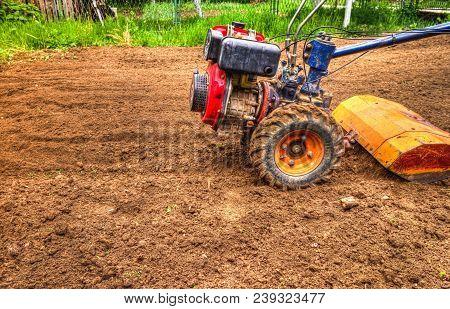 Plowing The Land With A Cultivator. Agriculture