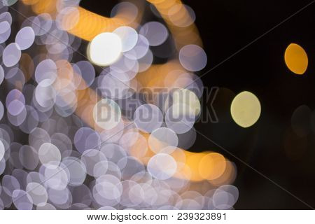 Blur Light Bokeh Abstrac Background In Music Light With New Year Lights Concept. Moving Party Lights