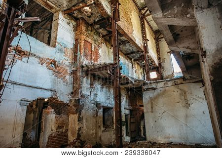 Ruins Of Industrial Building Interior After Disaster Or War Or Earthquake. Workshop With Collapsed F