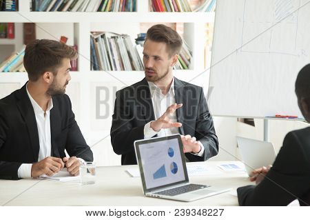 Business Worker Explaining New Startup Project To Colleague, Analyzing Company Reports And Annual Re