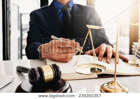 Law And Justice Concept, Attorney Or Lawyer Judgement Lawsuit With Holding Pen, Law Book,gavel And S
