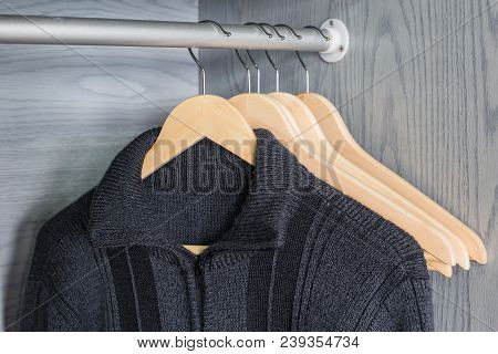 A Hanger With Things. Knitted Sweaters Hang On Hangers. Bright Sweaters. Spring Clothes.